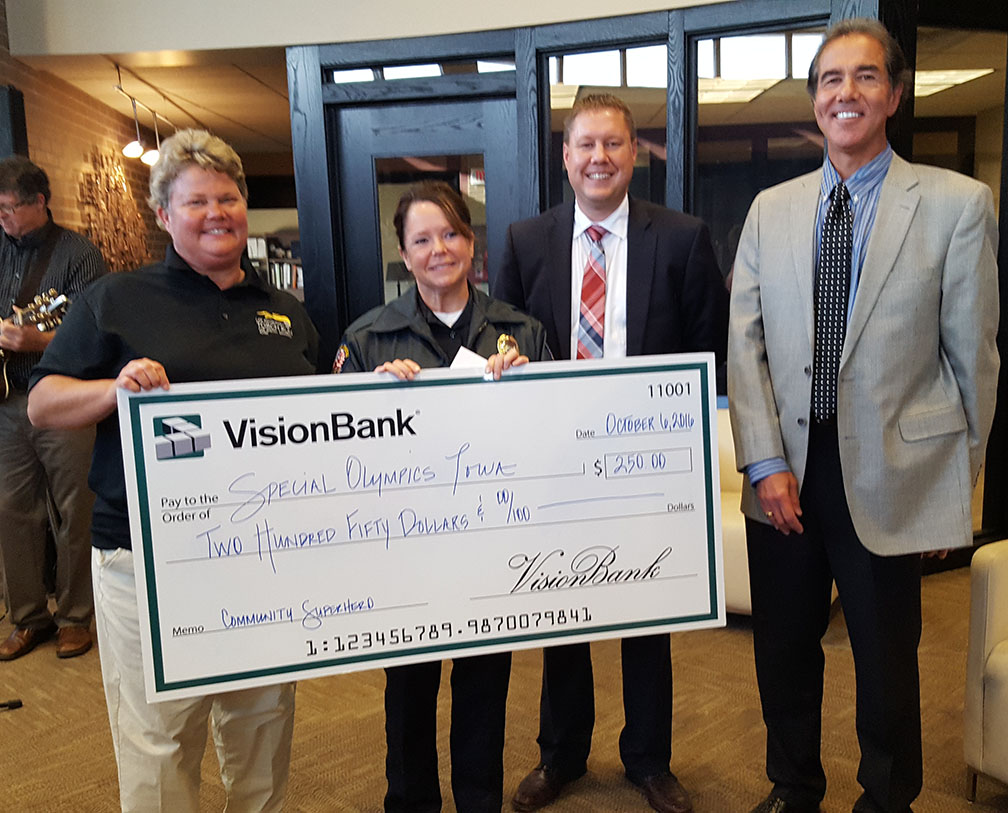 Photo of check donation to Special Olympics Iowa