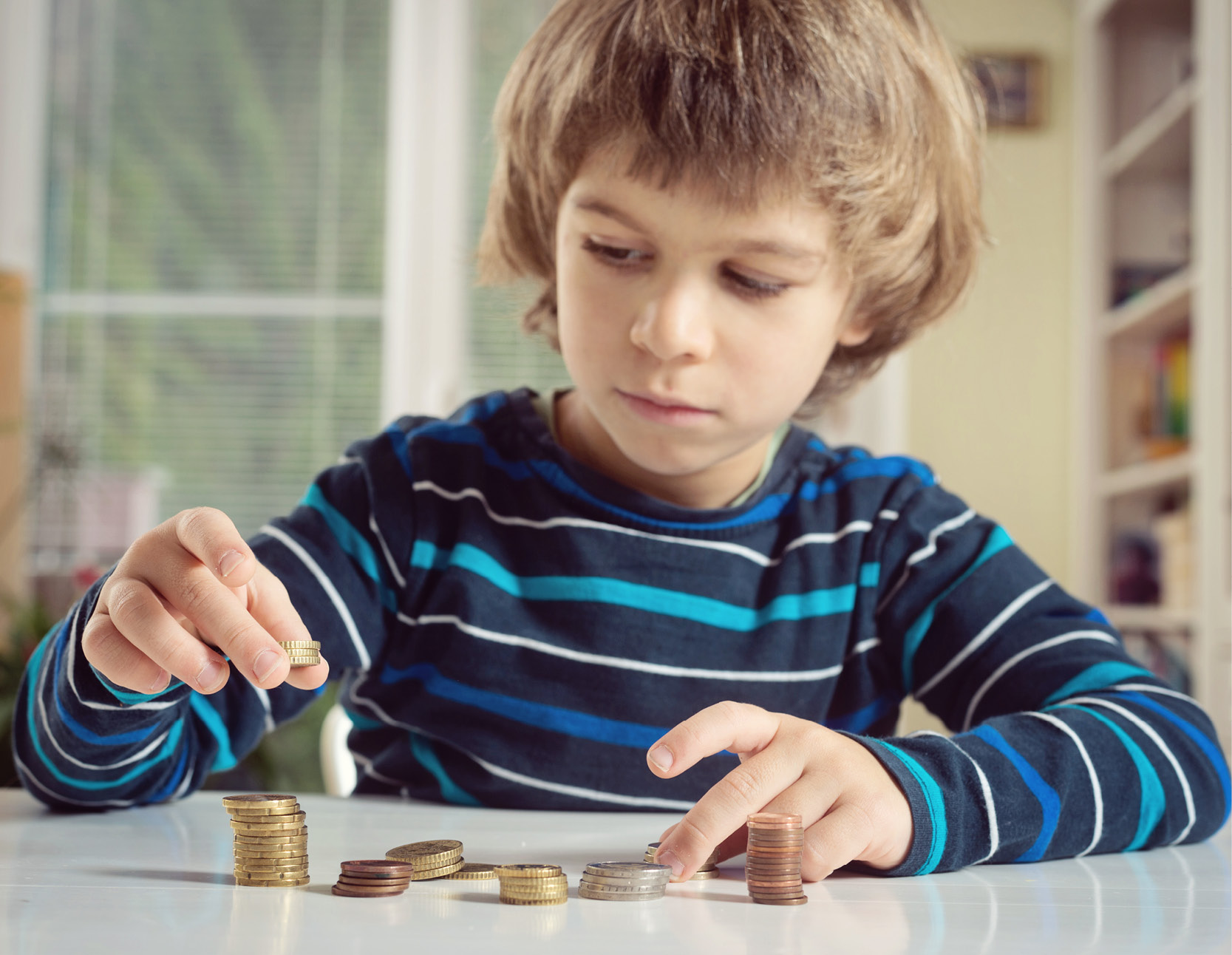 image of boy counting coins