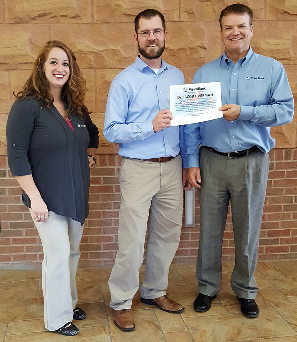 VisionBank presented our Community Superhero Ames Award to Dr. Jacob Overman for generosity including providing free dental services for families in need
