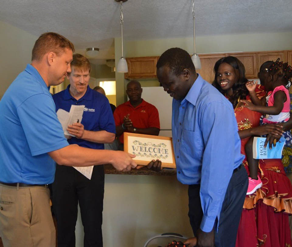 VisionBank was honored to present a plaque and house warming gift to the new owners of the home constructed with the panels we built the previous fall